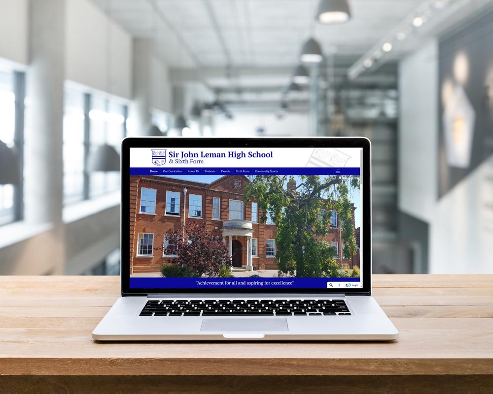 Computer screen showing code for the development of Sir John Leman High Schools website